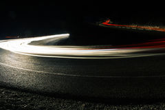 Bright car lines on night road Royalty Free Stock Image