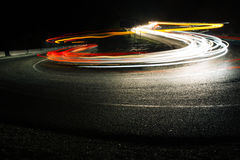 Bright car lines on night road. Exposured bright red and white lines from car riding on night road Stock Photography