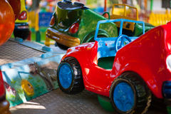 Bright car for little racer. Bright toy car in the amusement park Royalty Free Stock Photos