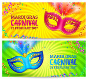 Bright carnival masks on yellow and green Mardi Grass banner templates Royalty Free Stock Photos