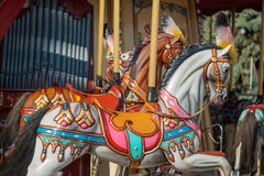 Bright carousel in a holiday park. Horses on a traditional fairground vintage carousel. Stock Photography