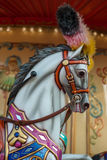 Bright carousel in a holiday park. Horses on a traditional fairground vintage carousel. Royalty Free Stock Photos