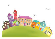 Bright cartoon houses on a hill Royalty Free Stock Photo
