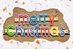 Bright celebratory Christmas greeting with snowy frame. Bright celebratory Christmas greeting on wooden background with snowy frame stock photo