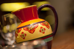 Bright ceramic pitcher with ornament. Beautiful clay jug with Oriental ornaments Royalty Free Stock Images