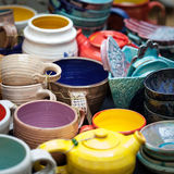 Bright ceramic tableware is a beautiful ornament. Bright pottery with artistic ornamental pattern Stock Images