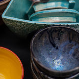 Bright ceramic tableware is a beautiful ornament. Bright pottery with artistic ornamental pattern Stock Photo
