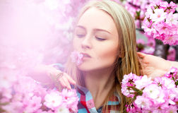 Bright charming woman with flower in mouth Royalty Free Stock Photo