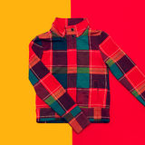 Bright checkered jacket. On colored background Stock Photo