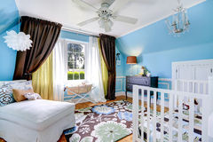 Bright cheerful nursery room interior Stock Images