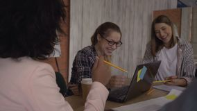 Bright cheerful cheerful women laugh at the meeting. 4K. Bright cheerful cheerful women laugh at the meeting stock video