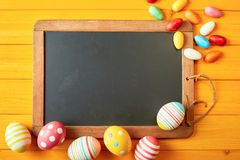 Bright cheerful yellow Easter background with eggs Stock Photography