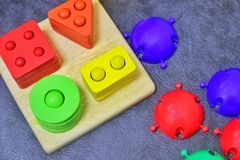 Bright children`s educational toys, puzzles, mosaic stock photography