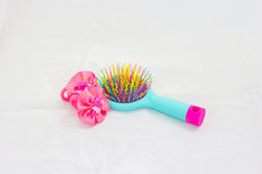 Bright children`s Massage hairbrush with hairpins it is isolated. Bright children`s Massage hairbrush with hairpins on a white background Stock Photography