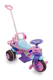 Bright children's tricycle with handle Stock Photos