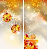 Bright Christmas background. Set of two greeting-cards of Bright Christmas background with two evening balls and gift Royalty Free Stock Photography