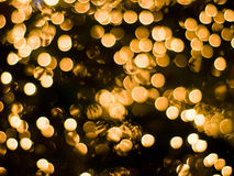 Bright christmas background. Bright golden christmas lights as a background Royalty Free Stock Photo
