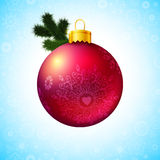 Bright Christmas ball and fir tree branch. Royalty Free Stock Images