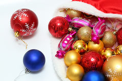Bright christmas baubles, toys in bag Stock Image
