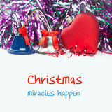 Bright christmas composition with red toy heart and bells (with easy removable sample text). White isolated background. Stock Images