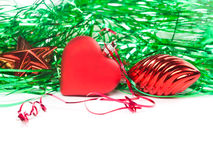 Bright christmas composition with red toy heart, toy strobile and star. Stock Photography