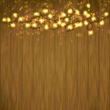 Bright Christmas Light garland over wooden table Stock Images
