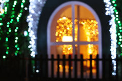 Bright Christmas lights at night, blurry Christmas lights, abstract background Royalty Free Stock Image