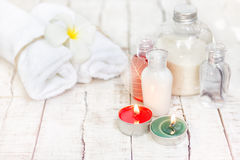 Bright Christmas spa background with white towels, green and red Royalty Free Stock Images