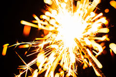 Bright Christmas sparkler closeup on a black background, soft focus Royalty Free Stock Image