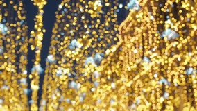 Bright Christmas Street Illumination. The City is Decorated for the Christmastide Holiday. New Year Lights Decorating. Shimmering bokeh stock footage
