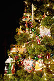Bright Christmas Tree. Colorful Chrismas tree full of ornaments, focus on the foreground, blurred background Stock Photos