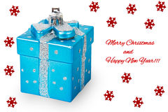 Bright Christmas tree toy blue gift box with red snowflares and Stock Photography
