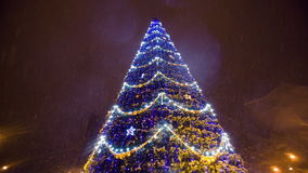 Bright Christmass tree with garland at city stock footage