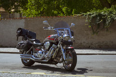 Bright chrome plated motorcycle is on Sunny street Stock Image