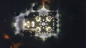 Bright Church with Golden domes and crosses. Glows in the night Park. Drone footage. Top and side view. Evening Cathedral in the Park. Bright temple. Modern royalty free stock photos
