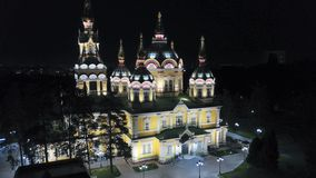 Bright Church with Golden domes and crosses. Glows in the night Park. Drone footage. Top and side view. Evening Cathedral in the Park. Bright temple. Modern stock photos