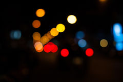 Bright circles from streetlamps on defocused photo of night stre Stock Image