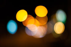 Bright circles from streetlamps on defocused photo of night stre Royalty Free Stock Photos