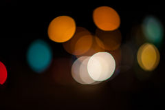 Bright circles from streetlamps on defocused photo of night stre Stock Photography
