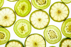 Bright citrus lime and kiwi slices on white Stock Images