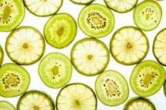 Bright citrus lime and kiwi slices on white Stock Photos