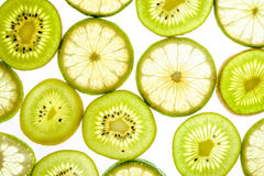 Bright citrus lime and kiwi slices on white Royalty Free Stock Images