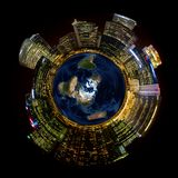 Bright City Lights on Miniature Planet Earth. Bright city lights on miniature planet illustrates concept of growing energy usage on our earth's shrinking Stock Image