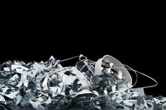 Bright clean scrap metal pile on a black background stock photography