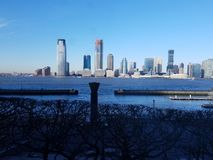 View from Manhattan across Hudson River to skyline in New Jersey. Bright clear sky. North Cove Marina in Manhattan, looking across at skyscrapers at Exchange royalty free stock photos