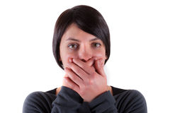 Bright closeup picture of woman with hand over mouth. Woman with hand over mouth Stock Photography