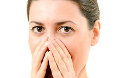 Bright closeup picture of woman with hands over mouth Royalty Free Stock Images