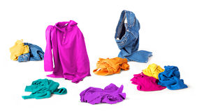Bright clothes fall to the floor. On a white background stock photo