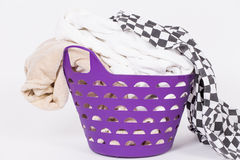 Bright clothes in a laundry basket Stock Photo