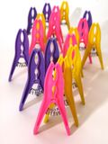 Bright clothes pegs standing on white background Royalty Free Stock Photo